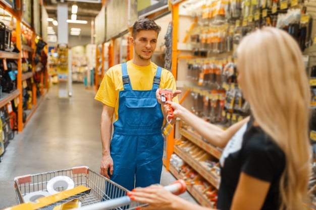 consultant and female purchaser in hardware store seller in uniform and woman in diy shop shopping in building supermarket 266732 713